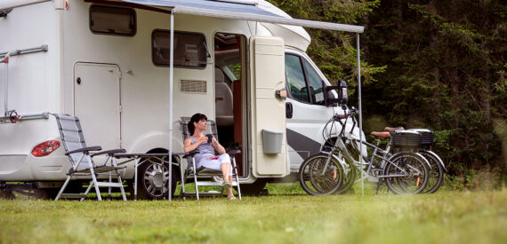 woman sat outside motorhome