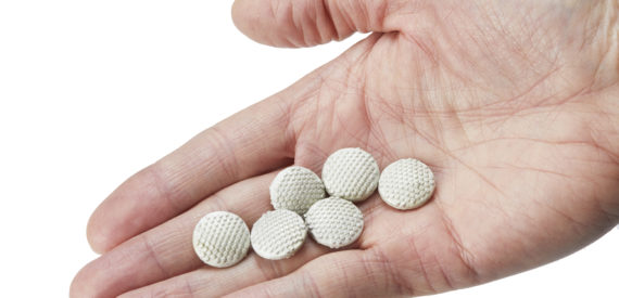 FTC pellets in palm of hand