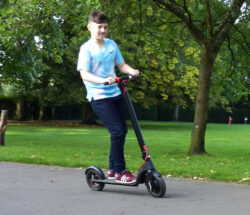 Young boy riding e10 electric scooter